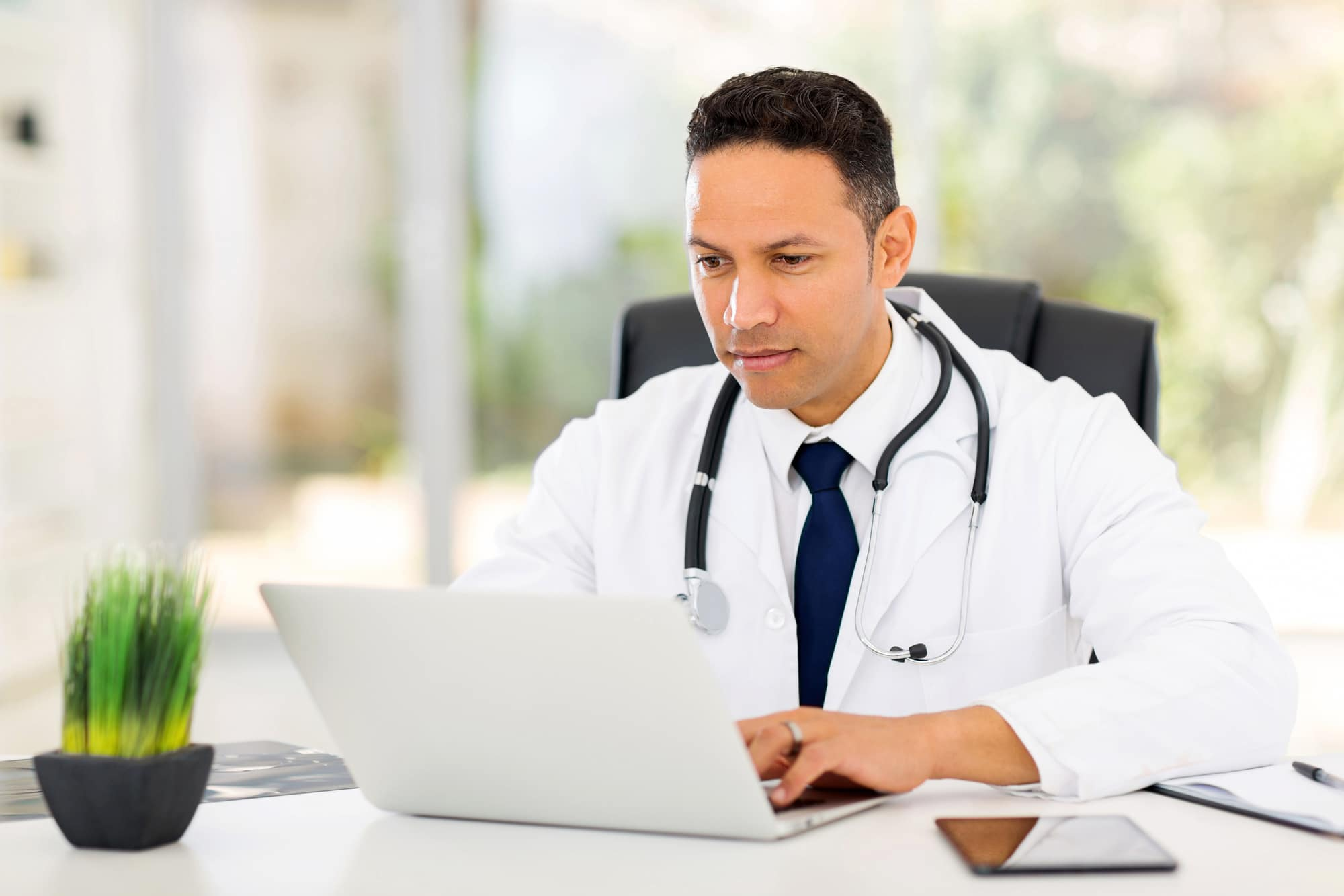 medical professional looking at laptop